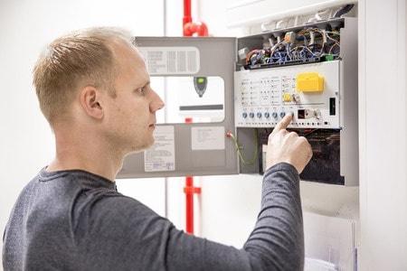 33033720 - technician checks fire panel in data center